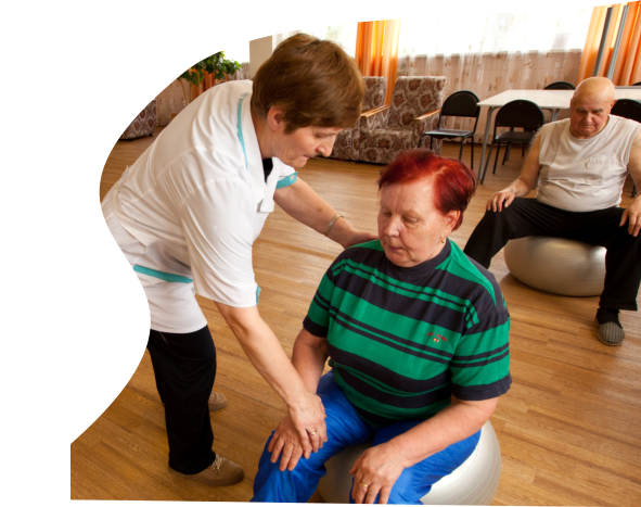 a caregiver and a senior female exercising