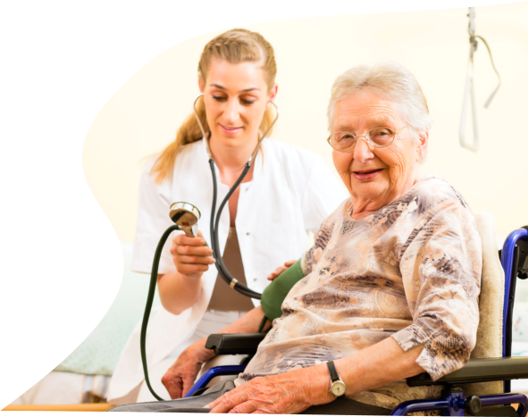 caregiver taking the blood pressure of a female senior