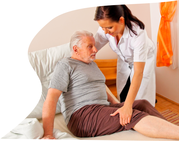 caregiver assisting a male senior off to bed
